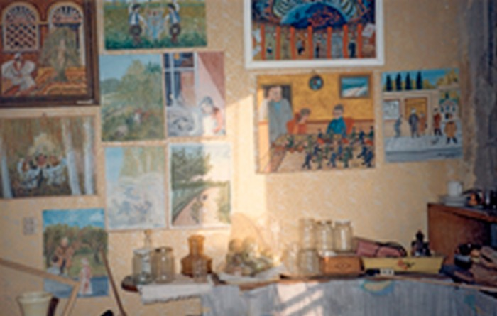 Stanisław's paintings in his house. 1980s.